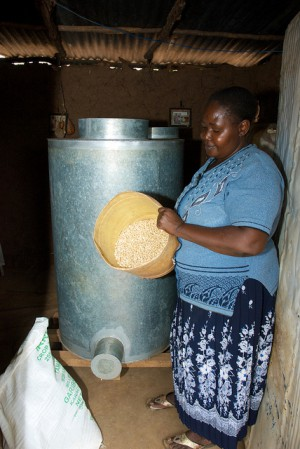 Esther Nduku in Embu, Kenya, stores clean, dry maize in a metal silo. Photo credit: CIMMYT.